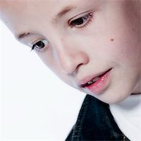 a model portrait of a young kid in the studio Stock Photo - Royalty-Freenull, Code: 400-03965350