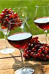 Three glasses of red wine with grapes on rustic table Stock Photo - Royalty-Free, Artist: Sandralise, Code: 400-03965754