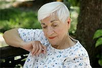 sleepy old woman - A sweet senior lady in the park resting and remembering. Stock Photo - Royalty-Freenull, Code: 400-03969296