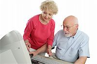 An a attractive senior couple using the computer together Stock Photo - Royalty-Freenull, Code: 400-03969325
