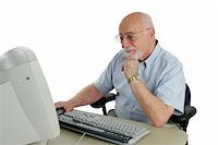 An intelligent senior man doing research online. Stock Photo - Royalty-Freenull, Code: 400-03969374