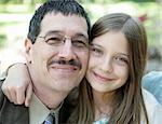 Portrait of a loving father and daughter outdoors.  Focus on Dad Stock Photo - Royalty-Free, Artist: lisafx, Code: 400-03970447