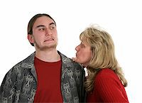 A mother trying to give her teen son a kiss.  He doesn't want a kiss. Stock Photo - Royalty-Freenull, Code: 400-03970451