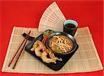 A delicious chinese dinner of hot & sour soup, fried fantail shrimp on a bamboo mat.  Complete meal with chopsticks & tea over red. Stock Photo - Royalty-Free, Artist: lisafx, Code: 400-03970931