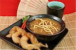 A bowl of hot & sour soup with chow mein noodles, fried fantail shrimp and hot tea. Stock Photo - Royalty-Free, Artist: lisafx, Code: 400-03970981