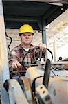 A heavy equipment operator driving a backhoe. Stock Photo - Royalty-Free, Artist: lisafx, Code: 400-03971129