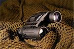 A military black spyglass laid on a camouflage mimetic green scarf Stock Photo - Royalty-Free, Artist: myper, Code: 400-03972579