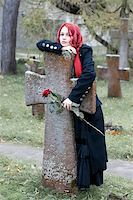 sad girls - Gothic girl with a rose on a cemetery Stock Photo - Royalty-Freenull, Code: 400-03972600