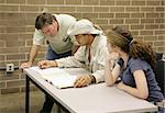 A teacher working with highschool or university students. Stock Photo - Royalty-Free, Artist: lisafx, Code: 400-03972910
