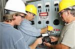 Group of electricians using an OHM meter to test voltage in an industrial power center.  All work being performed according to industry code and safety standards.  (note to inspector: OHMS on the meter is a unit of measurement not a trademark) Stock Photo - Royalty-Free, Artist: lisafx, Code: 400-03973082