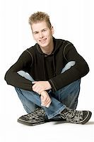 studio portrait of a young man smiling  Stock Photo - Royalty-Free, Artist: DNFStyle, Code: 400-03973421