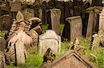 A view of the old Jewish cemetery in Prague. The tombstones are uneven due to age. Stock Photo - Royalty-Free, Artist: searagen, Code: 400-03978938