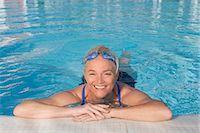 Mature woman in swimming pool Stock Photo - Premium Royalty-Freenull, Code: 614-03981986