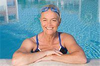 Mature woman in swimming pool Stock Photo - Premium Royalty-Freenull, Code: 614-03981987