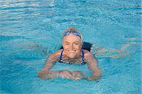 Mature woman swimming in pool Stock Photo - Premium Royalty-Freenull, Code: 614-03981990