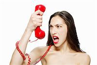 phone cord - Angry woman shouting into red telephone Stock Photo - Premium Royalty-Freenull, Code: 614-03982054