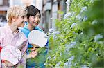 Two Young Women Wearing Yukata Looking By Flower Plants Stock Photo - Premium Rights-Managed, Artist: Aflo Relax, Code: 859-03983227