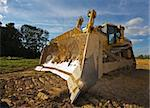 Dirty yellow bulldozer photographed in a sunny summer day Stock Photo - Royalty-Free, Artist: MikLav, Code: 400-03984353