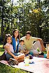 Hispanic family picnicking in the park and smiling at viewer. Stock Photo - Royalty-Free, Artist: iofoto, Code: 400-03999378