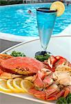 Platter of crab with lemons and parsley out by the pool Stock Photo - Royalty-Free, Artist: karimala, Code: 400-04001053