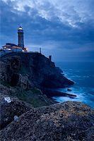 Mayor of Cape Lighthouse getting dark, Santander (Spain) Stock Photo - Royalty-Freenull, Code: 400-04001754