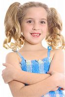 happy child with arms crossed Stock Photo - Royalty-Freenull, Code: 400-04003932