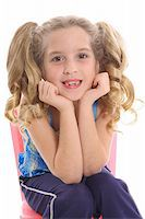 happy little girl with curly pig tails Stock Photo - Royalty-Freenull, Code: 400-04003933