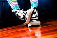girl in a waiting room. Close up of her footwear Stock Photo - Royalty-Freenull, Code: 400-04010637