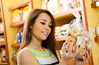 fat italian woman - woman in a supermarket reading nutrition information and comparing two products Stock Photo - Royalty-Freenull, Code: 400-04011229
