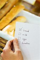 fat italian woman - woman in a supermarket checking his shopping list Stock Photo - Royalty-Freenull, Code: 400-04012842