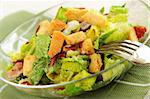 Fresh caesar salad with croutons and bacon bits served in a glass bowl Stock Photo - Royalty-Free, Artist: Elenathewise, Code: 400-04014668