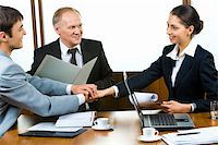 Photo of three partners holding the hands in the office Stock Photo - Royalty-Freenull, Code: 400-04017567