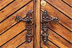 Double iron handle on a wooden door Stock Photo - Royalty-Free, Artist: lebanmax, Code: 400-04019308