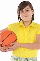 adorable girl whit ball of basketball a over white background Stock Photo - Royalty-Freenull, Code: 400-04019556