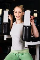 sweaty woman - Young woman goes in for sport using the training simulator in the gym Stock Photo - Royalty-Freenull, Code: 400-04020461