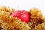 Red christmas tree bulb into gold decoration Stock Photo - Royalty-Free, Artist: alionakuz, Code: 400-04021109