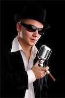 Singer with old fashioned mic and black hat Stock Photo - Royalty-Freenull, Code: 400-04021713