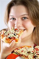 fat italian woman - Beautiful no make-up girl eating a piece of Pizza Stock Photo - Royalty-Freenull, Code: 400-04025292
