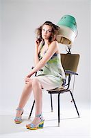 Sad pretty girl in dress with hair dryer Stock Photo - Royalty-Freenull, Code: 400-04030781