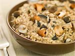 Bowl of Wild Mushroom Risotto with fork Stock Photo - Royalty-Free, Artist: MonkeyBusinessImages, Code: 400-04031499