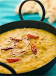 Karai Dish of Tarka Dhal with side of Naan Bread Stock Photo - Royalty-Free, Artist: MonkeyBusinessImages, Code: 400-04034091