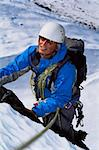 Young man mountain climbing on snowy peak Stock Photo - Royalty-Free, Artist: MonkeyBusinessImages, Code: 400-04036386
