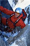 Young man mountain climbing on snowy peak Stock Photo - Royalty-Free, Artist: MonkeyBusinessImages, Code: 400-04036387