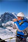 Young man warming hands on mountain peak Stock Photo - Royalty-Free, Artist: MonkeyBusinessImages, Code: 400-04036395