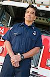 Portrait of a firefighter by a fire engine Stock Photo - Royalty-Free, Artist: MonkeyBusinessImages, Code: 400-04036417