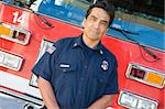 Portrait of a firefighter by a fire engine Stock Photo - Royalty-Free, Artist: MonkeyBusinessImages, Code: 400-04036418