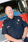 Portrait of a firefighter by a fire engine Stock Photo - Royalty-Free, Artist: MonkeyBusinessImages, Code: 400-04036419