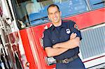 Portrait of a firefighter by a fire engine Stock Photo - Royalty-Free, Artist: MonkeyBusinessImages, Code: 400-04036420