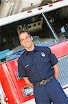 Portrait of a firefighter by a fire engine Stock Photo - Royalty-Free, Artist: MonkeyBusinessImages, Code: 400-04036421