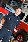 Portrait of a firefighter by a fire engine Stock Photo - Royalty-Free, Artist: MonkeyBusinessImages, Code: 400-04036422